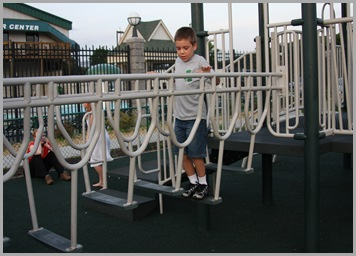 Landon on the playground equiptment