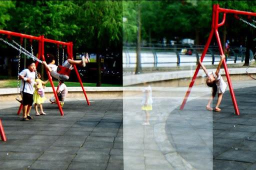 四號公園裡盪鞦韆的小孩們