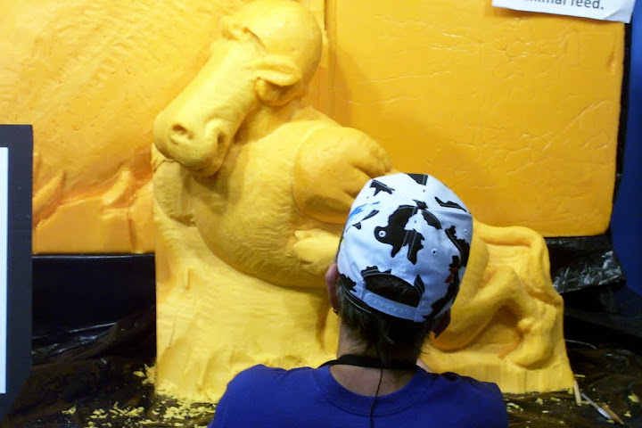 Giant cheese sculpture, with the head of the woman who was carving it at the time