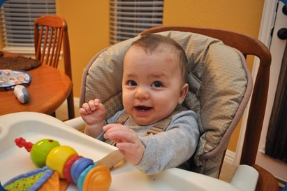 hudster playing in his high chair
