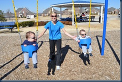 Mom and her boys getting the swingin' on