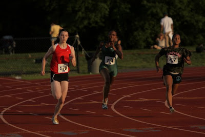 Sprinter Sara Gildersleeve coming off the turn in the 200m dash.
