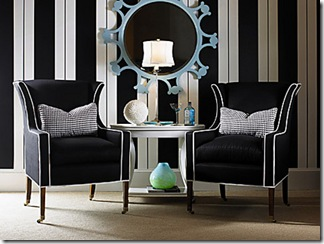 A modern take on a classic wing chair features upholstery in black woven acrylic boldly trimmed in white welting. The slender exposed wood legs have casters. Checkered houndstooth pillows extend the menswear theme and add punch. Here, black and white is dominant against a lively wall of stripes, where a sky-blue mirror stands out like a jewel. This chair from Century Furniture sells for $3,600.<br />Photo from Century Furniture<br />PRIMARY COLOR HG JAN08