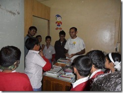 Nikhil and other volunteers with the students