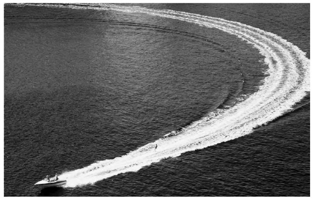 If this boat's wake were to cross the wake of another boat, the result would be both constructive and destructive interference.