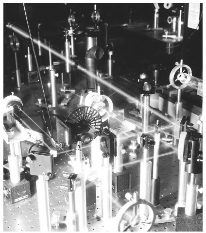 The beam of a mode locked, frequency doubled Nd YLF laser is reflected off mirrors and through filters at Colorado State University.