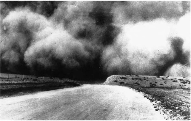 A cloud of topsoil is picked up by the wind near Boise City, Oklahoma, during the dust bowl of the 193ds. In some cases, wind removed 3-4 in. (7.6-1d.6 cm) of topsoil, turning acreage that once rippled with wheat into a desertlike wasteland.