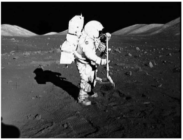 The author as a well-equipped astronaut on the Moon during the Apollo 17 mission in the Valley of Taurus-Littrow. He is using ''the rake'' sampling device to sift rock fragments from the finer portions of the regolith and has a 70-mm Hasselblad camera mounted on his chest (courtesy of NASA). This figure is available in full color at http:// www mrw. interscience.wiley. com/esst.
