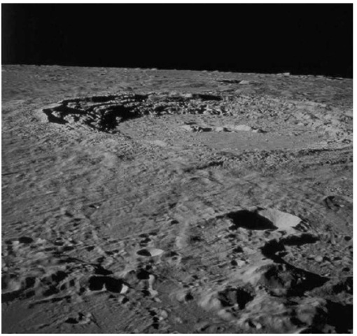 The 95-km diameter impact crater Copernicus as seen from the Apollo 17 Lunar Module Challenger after its departure from the Moon on 14 December 1972. Data from the Apollo 12 mission indicate that Copernicus formed about 900 m.y. ago (courtesy of NASA). This figure is available in full color at http://www.mrw.interscience.wiley.com/esst.