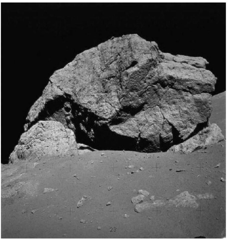 Contact between tan-gray, vesicular impact melt breccia (on the left) and blue-gray, clast-rich, nonvesicular impact breccia (on the right) in the boulder at Station 6 shown in Fig. 12 (courtesy of NASA). This figure is available in full color at http:// www mrw. interscience.wiley. com/esst.