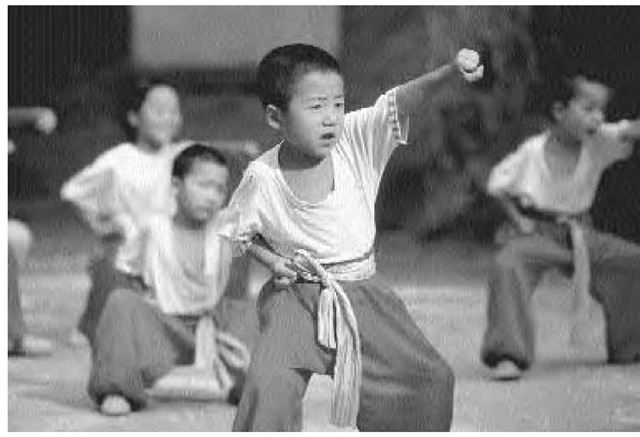 Chinese children in a martial arts class in Beijing, November 1997.