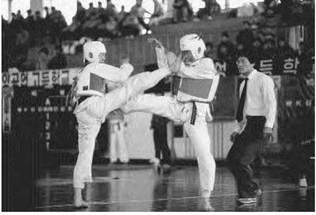 Junior high school students compete in a taekwondo tournament in Seoul, Korea, 1986.