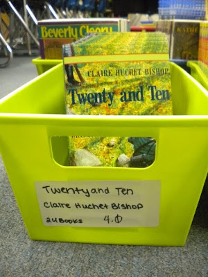 Each basket has a label with the book title, authors name, number of books and reading level