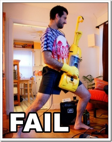 Guitar Fail - Man playing a vacuum  cleaner.