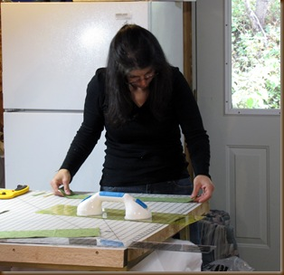 Gina cutting fabric