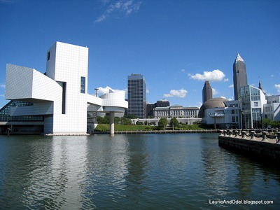 Rock and Roll Hall of Fame (left) with the Cleveland Skyline, on Lake Erie.