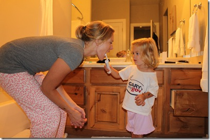 Abigail brushing mom's teeth 7-24-2010 12-18-38 AM
