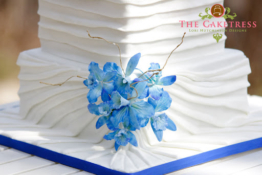Blue Orchids and White Draped Wedding Cake Three tier Cakes Toronto