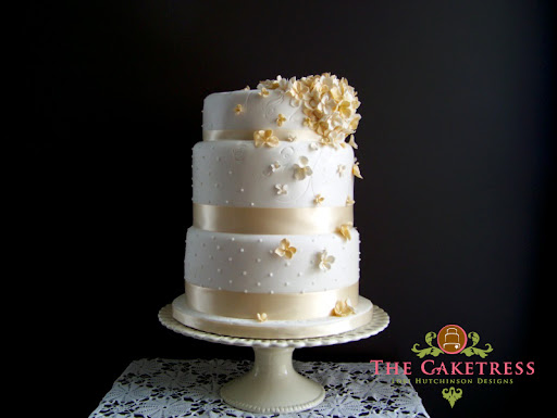 These small sugar flowers excel in striking decor of this wedding cake