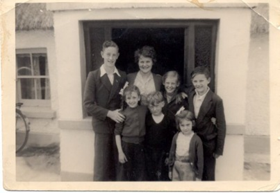 On holiday in the country i.e. Cloneygowan, Offaly. Maureen, Ken, Jean behind him and me with some of the neighbours.