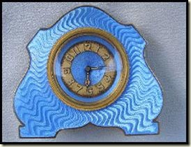 interesting shape turq clock