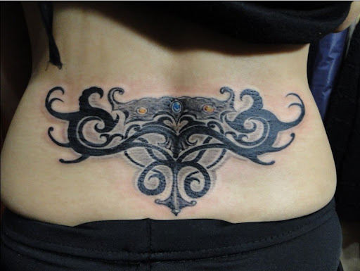 free tattoo designs for women. Lower Back Tattoo Designs
