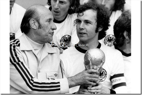 1974 FIFA World Cup Germany - Coach Helmut Schoen (left) and Franz Beckenbauer with theTrophy