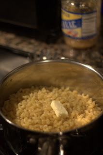 picture of adding garlic and butter to pasta