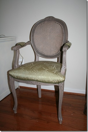 This Chair Is A Simple Side Chair, With Wooden Arms, An Upholstered Seat,  And Upholstered Arm Cushions.