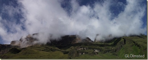 04 Clouds over the mountain above Keith Bush camp Drakensburg hike KwaZulu-Natal ZA pano (1024x411)