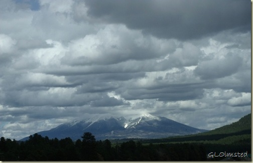 02 Cloudy sky with sun over Mt Humphreys I40E towards Flagstaff AZ (1024x656)