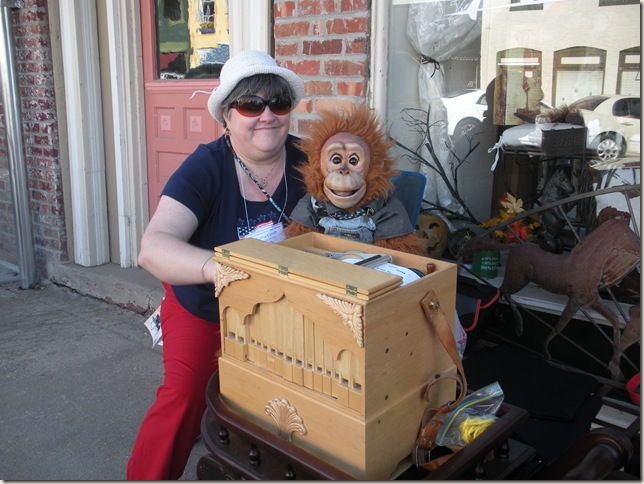 Organ grinder lady with monkey puppet