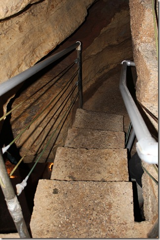 concrete steps down into the cave