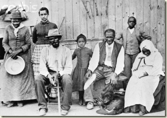 Harriet Tubman with a few people she helped during the Civil War. She is to the far left with a pan in her hands.