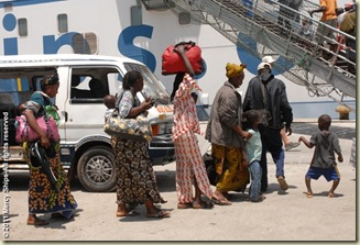 Patients took 5 hr to drive to the ship in 2 mini vans.  Here they unload and prepare to board the ship for admission process.