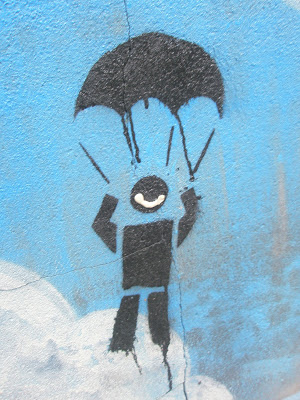 graffiti showing stick man on a parachute and someone has added a big smile
