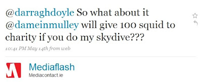 text reads: @darraghdoyle So what about it @dameinmulley will give 100 squid to charity if you do my skydive???