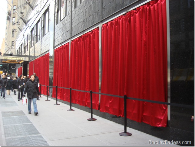 Red curtains covering the windows at Bloomingdales.