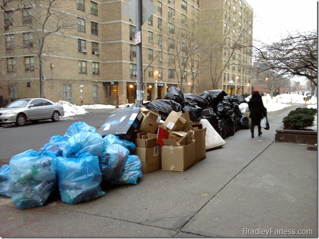 Trash piling up after the December 26th blizzard in New York City.