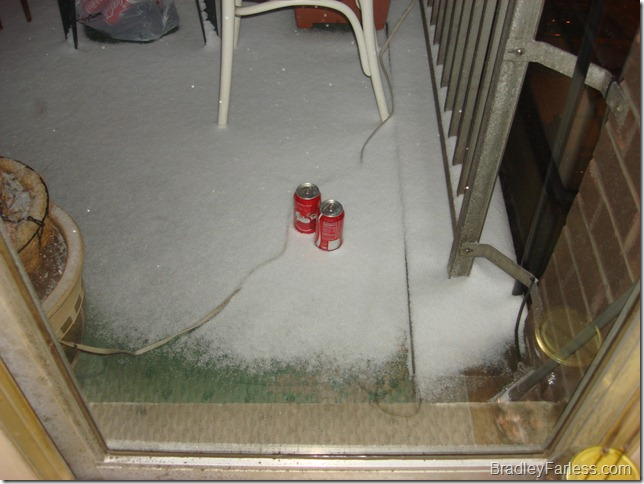 Cooling down two cans of Coke in the snow and cold on the balcony.