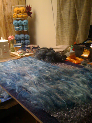 Laying out the second layer of batting -- sparkly!
