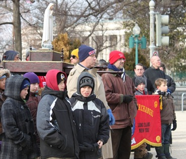 Roman Catholic demonstrators with image of Mary
