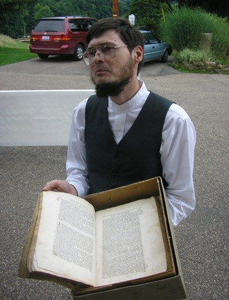 Seth Hinshaw displaying an old Quaker text