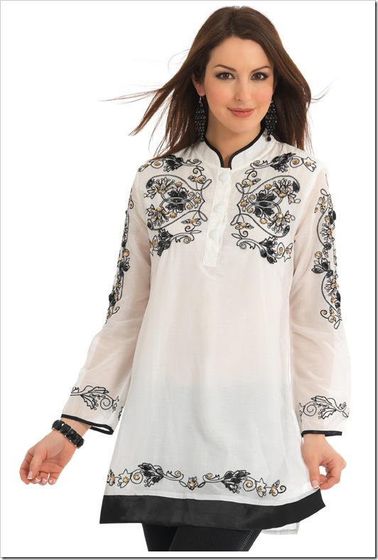 white kurta with black thread embroidery on it