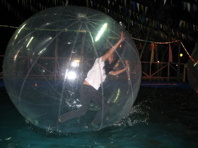 Eboi attempting to stand and walk on water inside the Zorb Ball