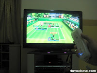 "Playing Wii Sports tennis on our Toshiba Regza 32"" LCD TV"