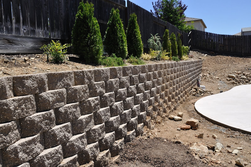 how to build a retaining wall next to a fence