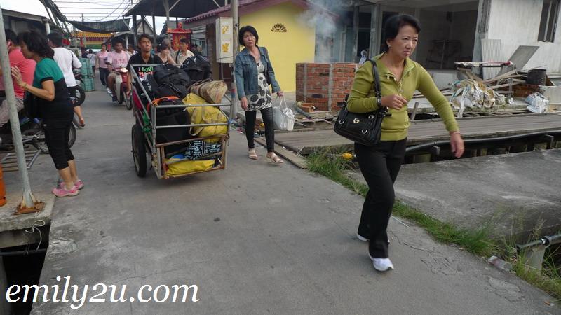 bag porters in Air Masin village