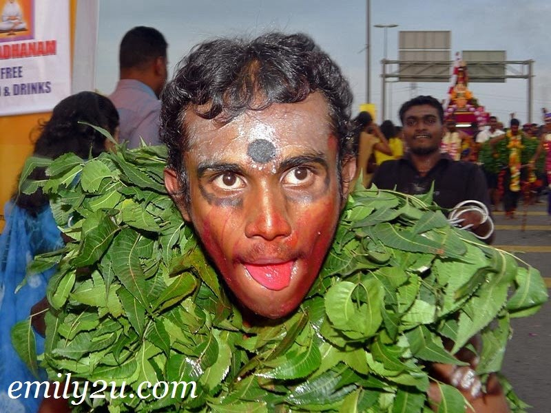 Thaipusam devotee in leaves
