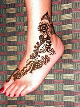female foot tattoo